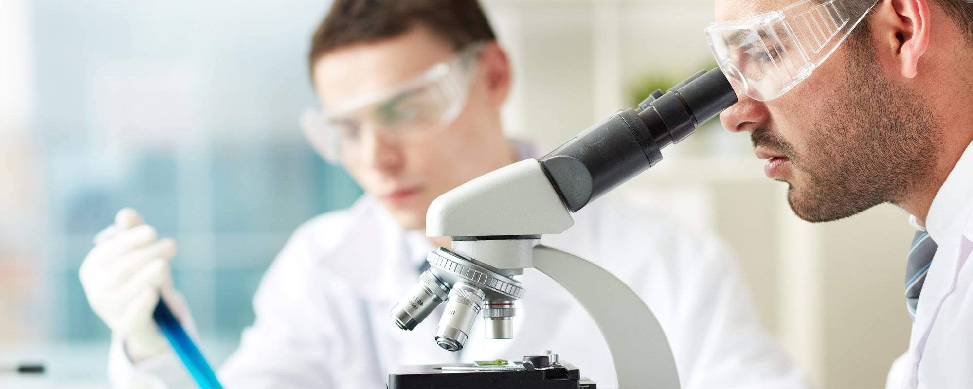 Professional Medical Doctor Using Microscope